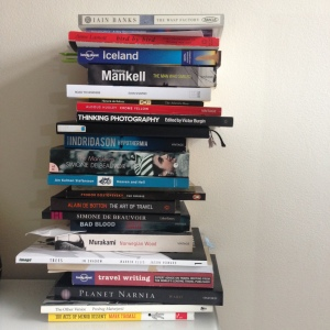 pile of books on a table