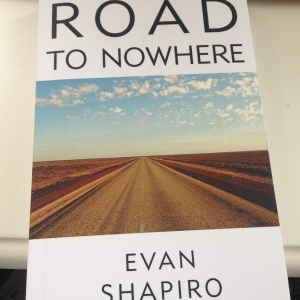 a book cover showing an empty road leading into a vanishing point